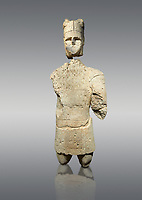 9th century BC Giants of Mont'e Prama  Nuragic stone statue of an archer, Mont'e Prama archaeological site, Cabras. Museo archeologico nazionale, Cagliari, Italy. (National Archaeological Museum) - Grey Background