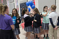 NWA Democrat-Gazette/CHARLIE KAIJO Students paint each other's faces during a Pi Day celebration, Thursday, March 13, 2019 at St. Vincent de Paul Catholic School in Rogers. <br /><br />Students at St. Vincent de Paul Catholic School celebrates Pi Day with a pie eating contest, games and a pi&Atilde;&plusmn;ata. Pi Day is an annual celebration of the mathematical constant &Iuml;&euro;. Pi Day is observed on March 14 since 3, 1, and 4 are the first three significant digits of &Iuml;&euro;.<br /><br />&quot;[We're] giving the kids an opportunity to get out of the classroom, do something fun and incorporate math,&quot; said Amy Liddell, seventh and eighth grade math teacher.