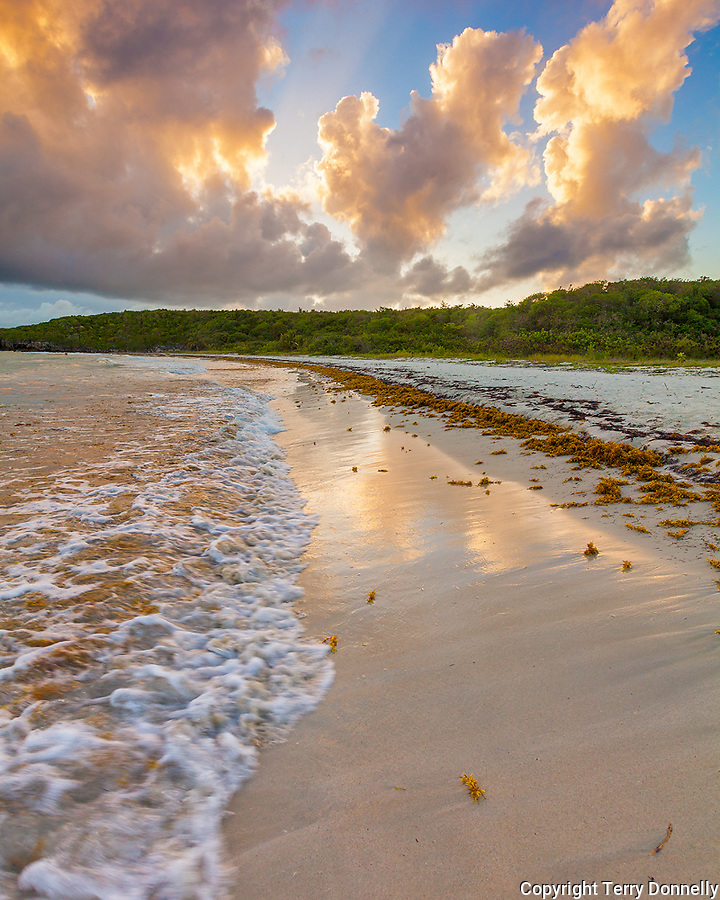 Vieques Island, Puerto Rico<br /> Evening clouds tower over surf of Red Beach