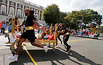 WATERBURY, CT - 08 OCTOBER 2017 -101417JW02.jpg -- The Waterbury YMCA team crosses the finish to win the 2017 United Way Bed Race Fundraiser Saturday afternoon. Jonathan Wilcox Republican-American