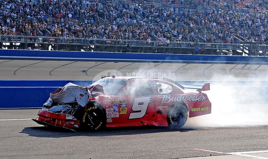 Oct. 11, 2009; Fontana, CA, USA; NASCAR Sprint Cup Series driver Kasey Kahne (9) after crashing during the Pepsi 500 at Auto Club Speedway. Mandatory Credit: Mark J. Rebilas-