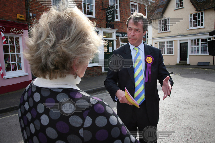 UKIP candidate Nigel Farage talking to residents in the market square of Winslow, Buckinghamshire, during the general election campaign.