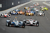May 28th Indianapolis Speedway, Indiana, USA;  Max Chilton, driver of the #8 Chip Ganassi Racing Honda, passes Will Power, driver of the #12 Team Penske Chevrolet, to take the lead on a restart during the running of the 101st Indianapolis 500 on May 28th, 2017 at the Indianapolis Motor Speedway in Indianapolis, IN.