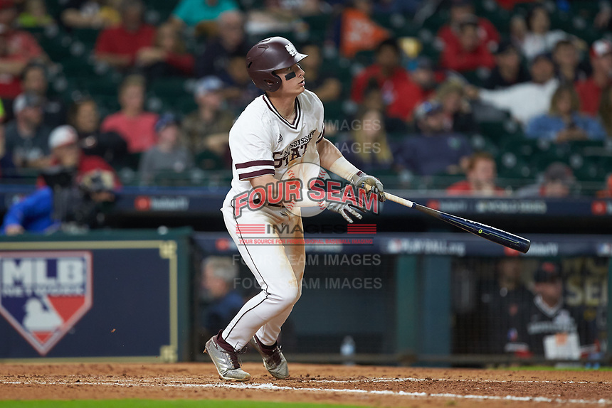Justin Foscue (17) of the Mississippi State Bulldogs follows through on his swing against the Houston Cougars in game six of the 2018 Shriners Hospitals for Children College Classic at Minute Maid Park on March 3, 2018 in Houston, Texas. The Bulldogs defeated the Cougars 3-2 in 12 innings. (Brian Westerholt/Four Seam Images)