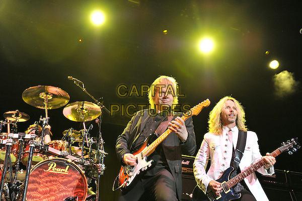 Styx - James Young & Tommy Shaw.Styx performing live at Wembley Arena, London, England..June 4th, 2011.stage concert live gig performance music half length black  suit guitar white .CAP/MAR.© Martin Harris/Capital Pictures.