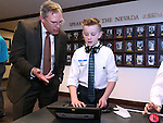 Intel education specialist Gregg Descheemaeker talks with Carson Middle School eighth-grader Ryan Maw during Digital Learning Day at the Legislative Building in Carson City, Nev., on Thursday, Feb. 5, 2015. Students from several Nevada schools talked with lawmakers and lobbyists about the Nevada Ready initative and the role technology in learning. <br /> Photo by Cathleen Allison