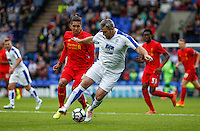 Steve McNulty of Tranmere Rovers turns Roberto Firmino of Liverpool during the 2016/17 Pre Season Friendly match between Tranmere Rovers and Liverpool at Prenton Park, Birkenhead, England on 8 July 2016. Photo by PRiME Media Images.