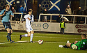 Forfar keeper Rab Douglas saves from Ayr Utd's Michael Donald.