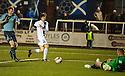 Forfar keeper Rab Douglas saves from Ayr Utd's Michael Donald.