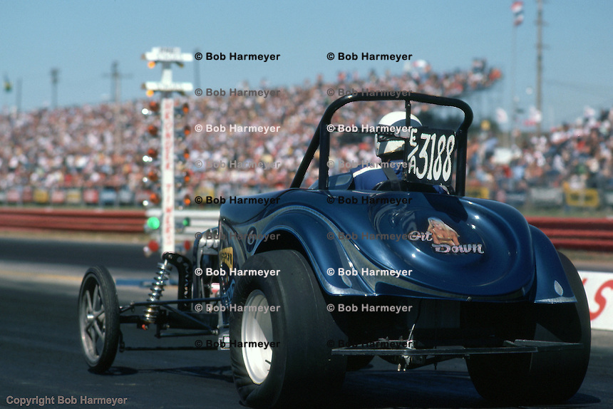 INDIANAPOLIS, INDIANA: A driver leaves the starting line during the 1976 NHRA US Nationals in Indianapolis, Indiana.