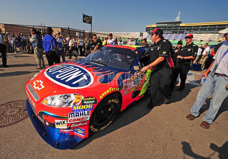 Sept. 28, 2008; Kansas City, KS, USA; The car of Nascar Sprint Cup Series driver Jeff Gordon is pushed through the garage prior to the Camping World RV 400 at Kansas Speedway. Mandatory Credit: Mark J. Rebilas-