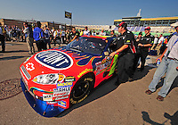 Sept. 28, 2008; Kansas City, KS, USA; The car of Nascar Sprint Cup Series driver Jeff Gordon is pushed through the garage prior to the Camping World RV 400 at Kansas Speedway. Mandatory Credit: Mark J. Rebilas-