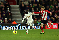 Pictured L-R: Nathan Dyer of Swansea chased by Steven Davis of Southampton Sunday 01 February 2015<br /> Re: Premier League Southampton v Swansea City FC at ST Mary's Ground, Southampton, UK.
