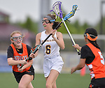 O'Fallon's Riley Maher (center) looks for an open teammate as she's pressured by Minooka's Maggie Struthers (left) and Victoria Cook. O'Fallon played Minooka in a quarterfinal game of the O'Fallon sectional at O'Fallon Sports Park on Monday May 20, 2019. <br /> Tim Vizer/Special to STLhighschoolsports.com