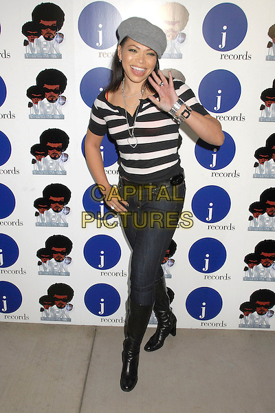 TISHA CAMPBELL.Alicia Keys One Night Only Performance at Bellavardo Studios, Los Angeles, California, USA..November 17th, 2007.full length grey gray hat jeans denim tucked into black boots white striped stripes top hand palm waving silver bracelets .CAP/ADM/BP.©Byron Purvis/AdMedia/Capital Pictures.