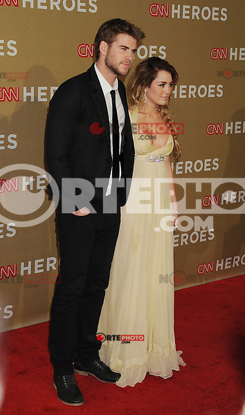 LOS ANGELES, CA - DECEMBER 11: Liam Hemsworth and Miley Cyrus arrive at 2011 CNN Heroes: An All-Star Tribute at The Shrine Auditorium on December 11, 2011 in Los Angeles, California.