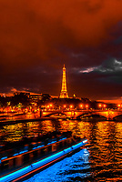 A bateau mouche on the River Seine, with the Eiffel Tower behind, Paris, France.