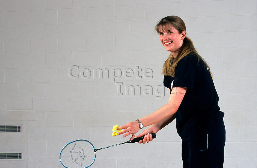 Woman about to serve in a game of badminton