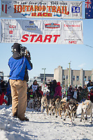 Sonny Lindner and team leave the ceremonial start line at 4th Avenue and D street in downtown Anchorage during the 2014 Iditarod race.<br /> Photo by Jim R. Kohl/IditarodPhotos.com