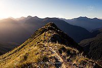 Hiking down from the Brewster Hut at Haast Pass, landscape photographer Christopher Thompson was treated to a gorgeous still sunset over the mountain tops... just the best time of day!