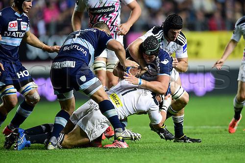 29.05.2015. Paris, France. Top 14 rugby playoff. Stade Francais versus Racing Metro.  Heinke Van Der Merwe (Stade Francais) tackles Tomas LAVANINI (RM92)