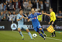 Justin Mapp (21) Montreal midfielder holds off Kansas City defender Matt Besler..Sporting Kansas City defeated Montreal Impact 2-0 at Sporting Park, Kansas City, Kansas.