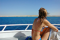 Girl on board a yacht in Red Sea near Naama Bay, Sharm El-Sheikh, Sinai, Egypt