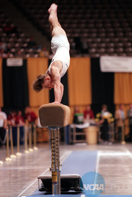 Caption: 19 APR 1997: Trent Wells of California placed ninth on the vault during the Division 1 Men's Gymnastics Championship at the Carver Hawkeye Arena on the University of Iowa campus in Iowa City, IA. Dave Peterson/NCAA Photos