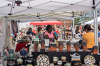 Thousands of shoppers and foodies arrive at the LIC Flea & Food in the Long Island City neighborhood of Queens in New York on opening day, Saturday, June 15, 2013.  The newest addition to the city's burgeoning trendy flea markets, the 24,000 square foot outdoor weekend market strives to compete with its upscale competitors in Brooklyn and Manhattan. The new market is centered around the new developments along the East River in Western Queens and hopes to attract locals, who have long bemoaned the lack of amenities, and visitors from other boroughs. (© Richard B. Levine)