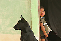 Indigenous kid and his dog on a remote location in Gran Sabana, Venezuela.  ..Many things remain unchanged in the area. and yet the arrival of the dish TV has radically changed others providing for a mix of culture and the inevitable impact of globalization.