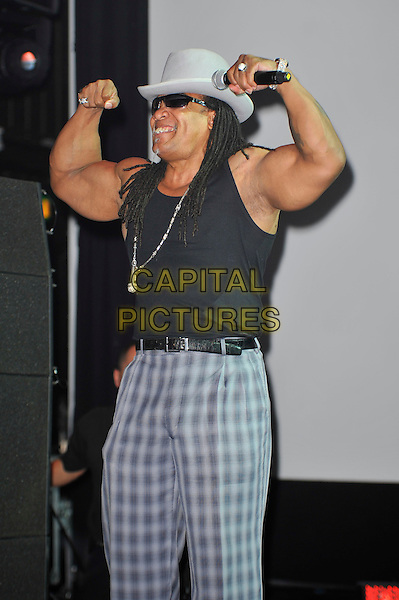 Melle Mel.performing at 'Something For Nothing: The Art of Rap'  European premiere, Hammersmith Apollo, London, England. 19th July 2012..show music live on stage concert gig.half length  black vest arms muscles grey gray suit tartan checked plaid hat cap sunglasses microphone  necklace trousers .CAP/MAR.© Martin Harris/Capital Pictures.