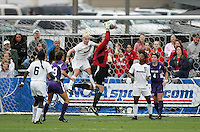 Portland goalkeeper Cori Alexander (in red) pulls down a corner while under pressure from Penn State's Zoe Bouchelle (33). The University of Portland Pilots defeated the Penn State University Nittany Lions 3-2 in a penalty kick shootout after the teams played to a 0-0 overtime tie at Aggie Soccer Stadium in College Station, Texas, Friday, December 2, 2005.
