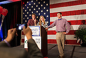 Catherine Ashworth, of Fuquay-Varina, takes her turn at the podium prior to the start of the State Republican Party in Raleigh, North Carolina, Election Day, November 6, 2012. Also pictured are students Bennett Yeargan, left, and Rory Neer, right. .