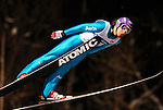 Martin Schmitt of Germany soars through the night skies during the FIS World Cup Ski Jumping in Sapporo, northern Japan in February, 2008.
