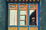 Lhasa, Tibet, a boy in a window of Jokhang Temple