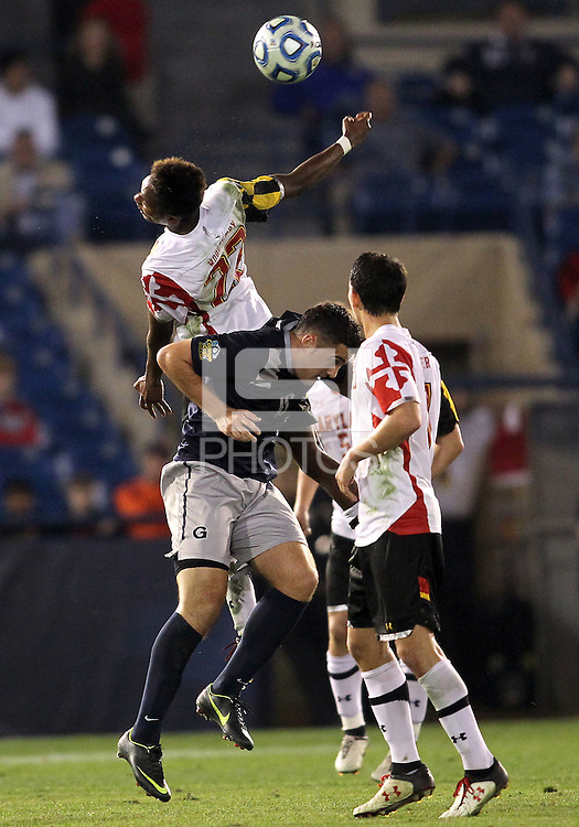 HOOVER, AL - DECEMBER 07, 2012:  London Woodberry (22) of the University of Maryland wins A header against Brandon Allen (10) of Georgetown University during an NCAA 2012 Men's College Cup semi-final match, at Regents Park, in Hoover , AL, on Friday, December 07, 2012. The game ended in a 4-4 tie, after overtime Georgetown won on penalty kicks.