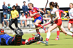 Mannheim, Germany, April 18: During the 1. Bundesliga Damen match between TSV Mannheim (white) and Mannheimer HC (red) on April 18, 2015 at TSV Mannheim in Mannheim, Germany. Final score 1-7 (1-4). (Photo by Dirk Markgraf / www.265-images.com) *** Local caption *** Sophie Ruppert # of TSV Mannheim, Greta Lyer #10 of Mannheimer HC