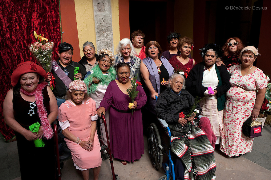 Residents of Casa Xochiquetzal pose for a group photograph, after a beauty contest at the shelter in Mexico City, Mexico on November 20, 2008. Casa Xochiquetzal is a shelter for elderly sex workers in Mexico City. It gives the women refuge, food, health services, a space to learn about their human rights and courses to help them rediscover their self-confidence and deal with traumatic aspects of their lives. Casa Xochiquetzal provides a space to age with dignity for a group of vulnerable women who are often invisible to society at large. It is the only such shelter existing in Latin America. Photo by Bénédicte Desrus