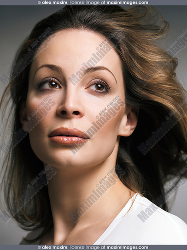 Beauty portrait of a woman with light brown hair and natural makeup in her thirties