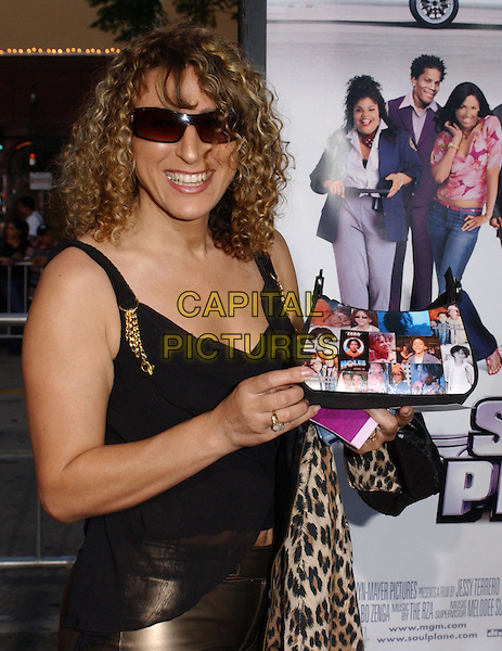 KHLEO THOMAS' MOTHER RAQUELLE.At the MGM Pictures' World Premiere of Soul Plane, held at The Mann Village Theatre in Westwood, California,.May 17,2004.half length half-length holds up bag with photos of Khelo on it..*UK sales only*.www.capitalpictures.com.sales@capitalpictures.com.©Debbie Van Story/Capital Pictures