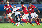 (C) Douglas Costa of Bayern Munich being followed by (R) Paulinho of Guangzhou Evergrande during the Bayern Munich vs Guangzhou Evergrande as part of the Bayern Munich Asian Tour 2015  at the Tianhe Sport Centre on 23 July 2015 in Guangzhou, China. Photo by Aitor Alcalde / Power Sport Images