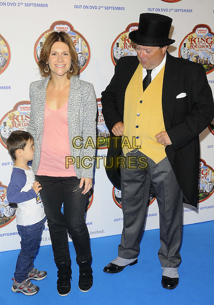Harriet Scott &amp; guests<br /> attended the &quot;Thomas &amp; Friends: King of the Railway&quot; VIP film screening, Vue West End cinema, Leicester Square, London, England.<br /> August 18th, 2013<br /> full length kid child blue jeans denim grey gray pattern blazer pink top yellow waistcoat black top hat hiding funny scared <br /> CAP/CAN<br /> &copy;Can Nguyen/Capital Pictures