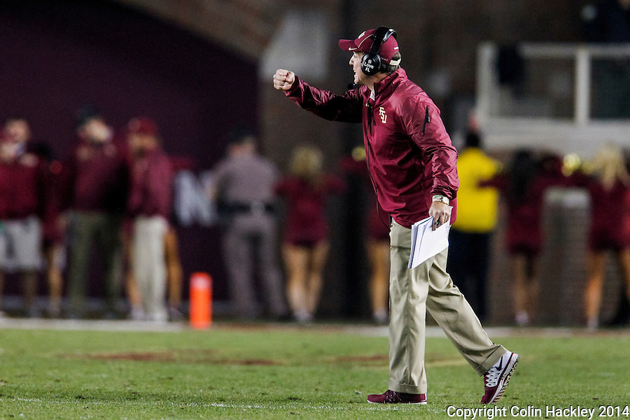 TALLAHASSEE, FL 11/29/14 FSU-UF112914-Florida State Head Coach Jimbo Fisher directs his team against the University of Florida during second half action Saturday at Doak Campbell Stadium in Tallahassee. The Seminoles beat the Gators 24-19.<br /> COLIN HACKLEY PHOTO