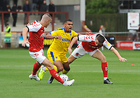 AFC Wimbledon's Kwesi Appiah under pressure from Fleetwood Town's Paul Coutts and Jordan Rossiter<br /> <br /> Photographer Kevin Barnes/CameraSport<br /> <br /> The EFL Sky Bet Championship - Fleetwood Town v AFC Wimbledon - Saturday 10th August 2019 - Highbury Stadium - Fleetwood<br /> <br /> World Copyright © 2019 CameraSport. All rights reserved. 43 Linden Ave. Countesthorpe. Leicester. England. LE8 5PG - Tel: +44 (0) 116 277 4147 - admin@camerasport.com - www.camerasport.com