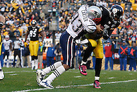 PITTSBURGH, PA - OCTOBER 30: Ben Roethlisberger #7 of the Pittsburgh Steelers is sacked by Andre Carter #93 of the New England Patriots during the game on October 30, 2011 at Heinz Field in Pittsburgh, Pennsylvania.  (Photo by Jared Wickerham/Getty Images)