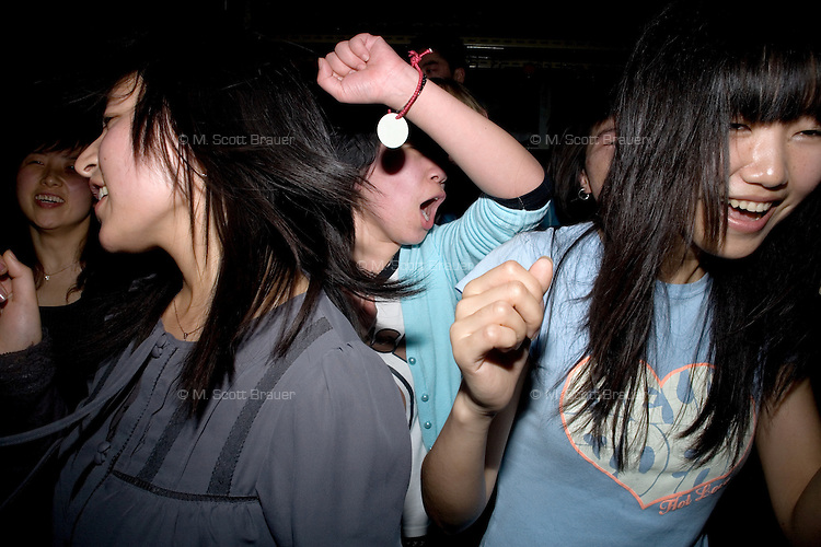 Girls dance at a punk concert at Castle Bar in Nanjing, China.