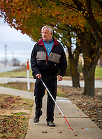 NWA Democrat-Gazette/JASON IVESTER <br /> David Henry walks north on the sidewalk on Wednesday, Nov. 25, 2015, alongside Been Road in Bentonville.