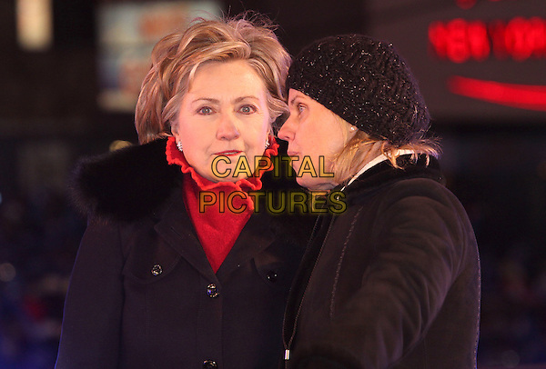 SENATOR HILLARY CLINTON.The Former president and guests lowered the ball at Times Square during the New Year's Eve Celebration to ring in 2009, New York, NY, USA, 31 December 2008..New year's years Eve half length cold gloves black coat fur collar.CAP/ADM/PZ.©Paul Zimmerman/Admedia/Capital Pictures