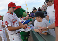 Pitcher Brandon Workman (32) of the Greenville Drive, Class A affiliate of the Boston Red Sox, signs autographs prior to a game against the Augusta GreenJackets on April 7, 2011, at Fluor Field at the West End in Greenville, S.C. Photo by Tom Priddy / Four Seam Images