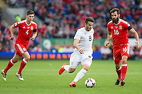 Valeri Kazaishvili of Georgia gets past Ben Davies and Joe Ledley of Wales during the FIFA World Cup Qualifier match between Wales and Georgia at the Cardiff City Stadium, Cardiff, Wales on 9 October 2016. Photo by Mark  Hawkins / PRiME Media Images.